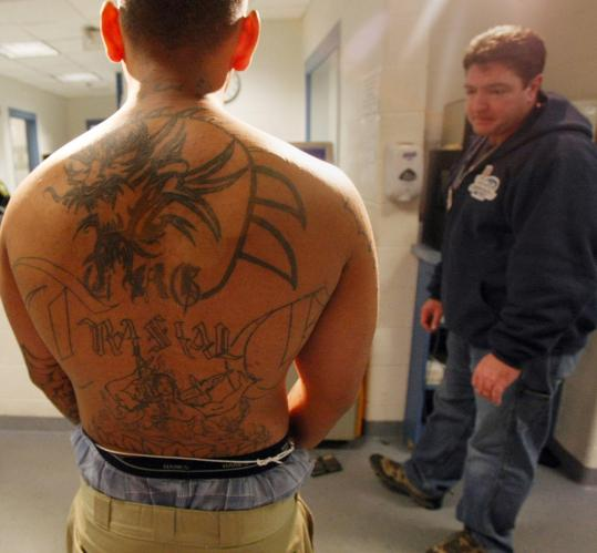 A reputed gang member had his tattoos photographed by Lynn officers,