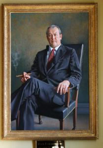 A painted portrait of Kevin B. Harrington, former Massachusetts Senate president, hangs in the Senate library.