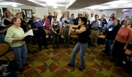 Lisa Gallatin leads singers in ''Der Yid Der Shmid'' last month in Brookline. A Besere Velt is the largest Yiddish chorus in the world.