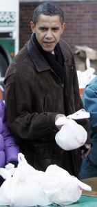 President-elect Barack Obama put down food to distribute last week at St. Columbanus Parish and School in Chicago.