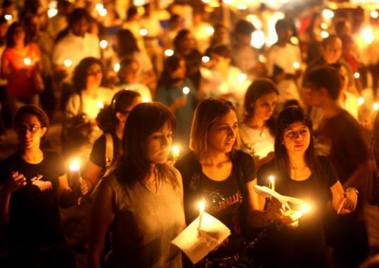 People held candles near The Oberoi Hotel in Mumbai, India, in a demonstration yesterday against the attacks.