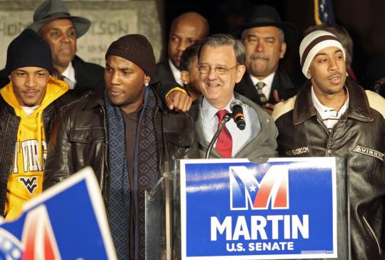 Jim Martin, the Democrat vying for the US Senate seat in Georgia, posed with rappers (from left) T.I., Young Jeezy, and Ludacris during a campaign rally in Atlanta.
