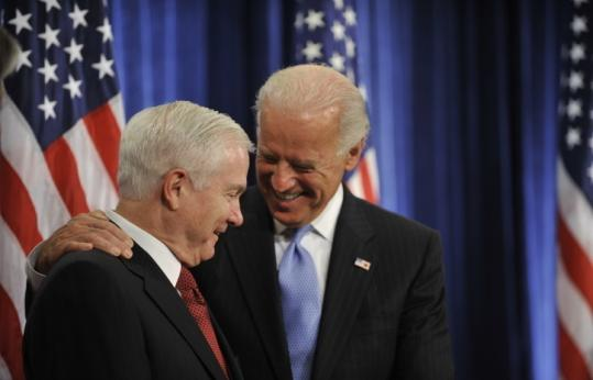 Vice President-elect Joseph Biden (right), with US Secretary of Defense Robert Gates at a news conference in Chicago.