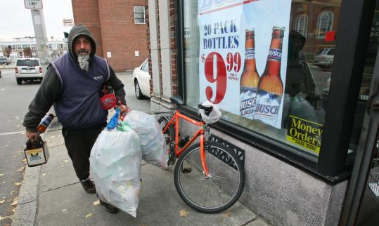 'Cans are very light,'' says Ken Sawicki, a homeless man who said he has seen more competition for bottles and cans in recent months. 'You can fit in more per square foot.''