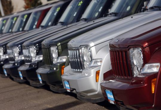 Unsold 2008 Liberty SUVs line a Chrysler-Jeep dealership in Centennial, Colo. Auburn Hills, Mich.-based Chrysler said sales slid 47 percent to 85,260 cars and trucks in November.