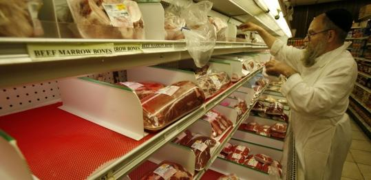 Rabbi Moishe Silverman stocked liver last week in a partially empty meat display at South Florida Kosher, a butcher shop in North Miami Beach, Fla.
