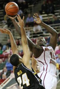 BC's Rakim Sanders, who had 6 points, gets off a shot over Iowa's Aaron Fuller in the first half last night at Conte Forum.