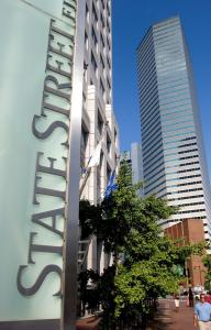 State Street is laying off just weeks after receiving $2 billion as part of the Treasury Department's plan to loosen lending.