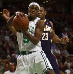 Rajon Rondo hauls in one of his 13 rebounds, this one at the expense of the Pacers' Stephen Graham in the second half.