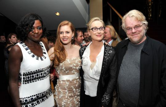 Viola Davis (left) joins costars (from left) Amy Adams, Meryl Streep, and Philip Seymour Hoffman at the post-premiere party for ''Doubt,'' in which Davis plays Mrs. Miller (below).