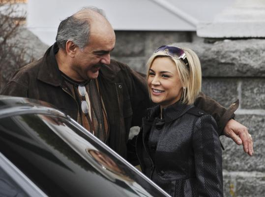 Maurice Chasse, actor and producer, and Samaire Armstrong take a break from filming.