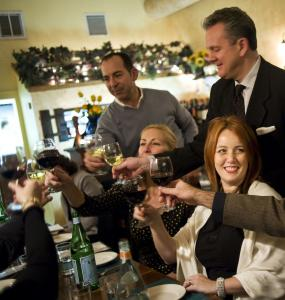 Heather Slaby (right) and friends give a toast at Trattoria Toscana during their annual pre-Thanksgiving dinner.