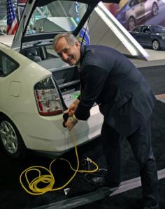 Phil Giudice, commissioner of Energy Resources, plugs in a Prius.