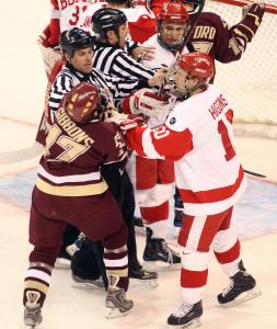Linesmen break up a shoving match between BC's Brian Gibbons and BU's Chris Higgins at Agganis Arena.