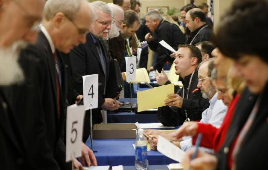 Candidates spoke to hiring personnel (at tables) about 200 job openings during a job fair Tuesday at BAE Systems in Nashua.