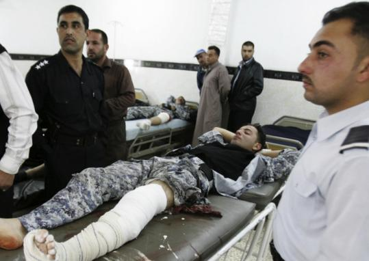 A police officer was injured in a suicide bomb attack near a checkpoint in Kirkuk yesterday that targeted police recruits.