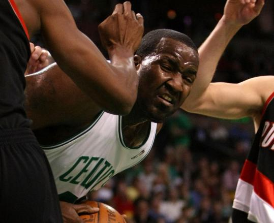 Despite being surrounded Friday, Kendrick Perkins still managed 12 points and 12 rebounds.