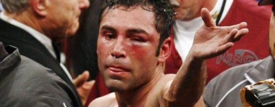 A beaten and battered Oscar De La Hoya throws in the towel.
