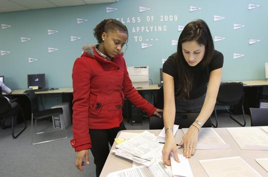 Sarah Hedges (right), a counselor at The Bottom Line, a nonprofit, helped Francisca Mendes with her college search.