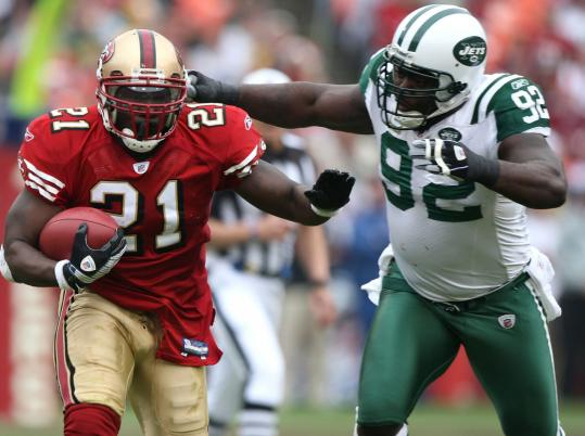 49ers running back Frank Gore blows past Jets end Shaun Ellis. San Francisco nearly doubled New York in time of possession.