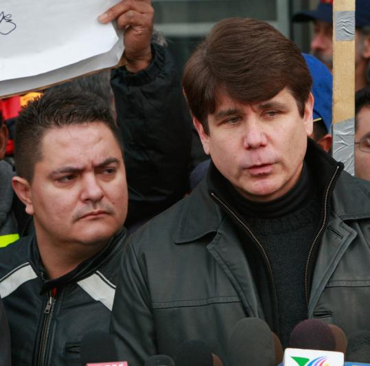 Illinois Governor Rod Blagojevich speaks to the media after visiting with workers occupying the Republic Windows and Doors factory in Chicago yesterday. About 200 workers occupy the facility, demanding compensation they say they are owed.