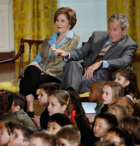 CHILDREN'S HOLIDAY AT WHITE HOUSE - President Bush and his wife, Laura, listened to entertainers in the East Room of the White House yesterday during the Children's Holiday Reception and Performance.