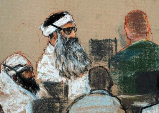 A sketch shows Khalid Sheikh Mohammed (center) and Walid Bin Attash (left) at the Guantanamo Bay Naval Base.