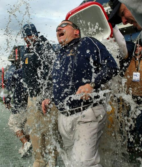 Arlington Catholic head coach Serge Clivio is drenched with water in the final seconds of a win over Norton.