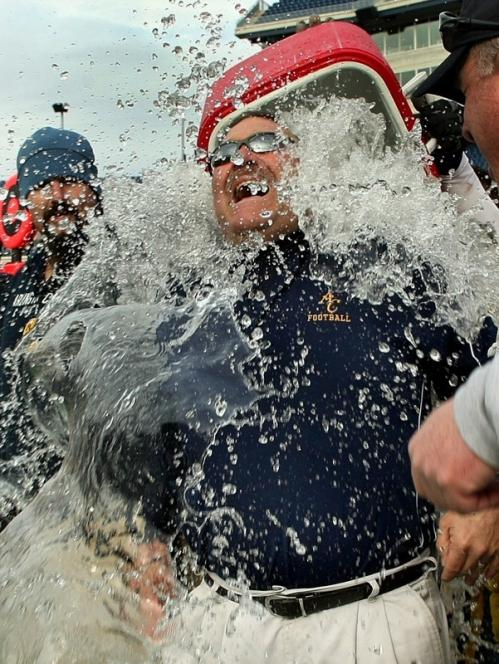Arlington Catholic head coach Serge Clivio is drenched with water with seconds remaining. Check out photos from all six of Saturday's Eastern Mass. Super Bowls at Gillette Stadium by following the links below: * BC High 13, Brockton 7 * Dracut 27, Marshfield 0 * Walpole 41, Mansfield 21 * Duxbury 46, Gloucester 26 * Amesbury 40, Vineyard 19 * AC 32, Norton 20 * M/E 36, Tri-County 6
