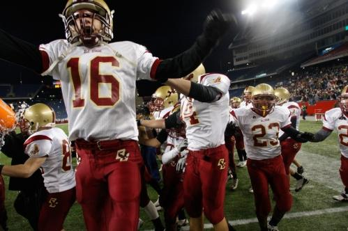 BC High players rush onto the field after their win over Brockton.