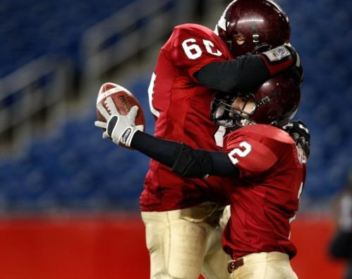 Gloucester's Ross Carlson (2) celebrates with teammate Andrew Porper.