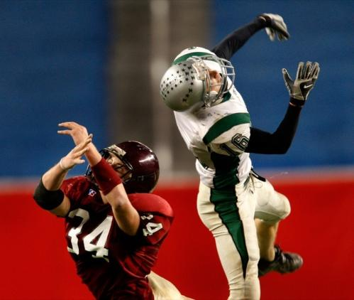 Both Duxbury's Colin McKenzie (16) and Gloucester's Christopher Unis come up empty going up for a first-half pass.