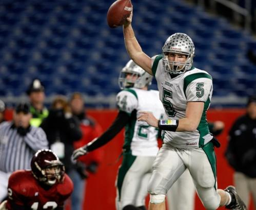 Duxbury's Shane DiBona (5) celebrates as he rumbles into the end zone.