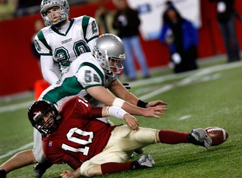 Gloucester QB Richard Gallant fumbles the ball on a fourth-quarter sack, which Duxbury's Will Shields (56) recovered.