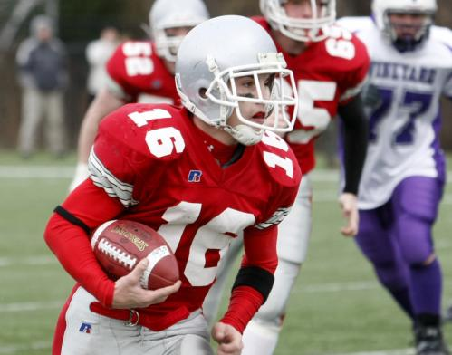 Amesbury's Jared Flannigan (16) runs the ball against Martha's Vineyard.