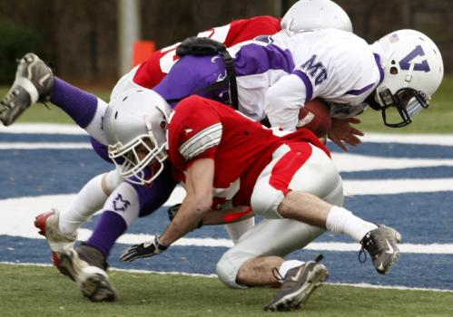 Martha's Vineyard's Nick Gross is tackled by Amesbury's Kevin Johnston (front) and Jared Flannigan.