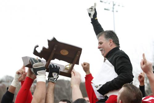 Amesbury's coach Thomas Connors celebrates with his team after they defeated Martha's Vineyard.