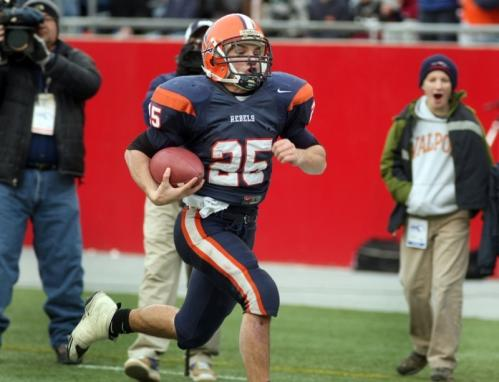 Walpole's Ryan Izzo runs for long yardage.