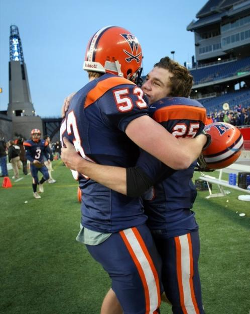 Walpole's Ryan Izzo (25) celebrates with Sean Driscoll (53).