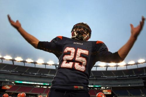 Walpole's Ryan Izzo celebrates the Rebels' triumph.