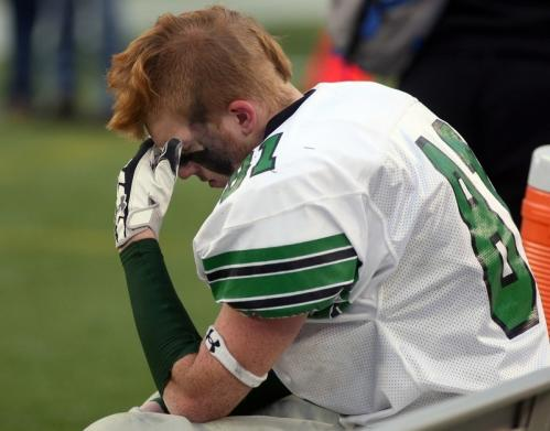 Mansfield's Shawn Kelley sits dejected on his bench.