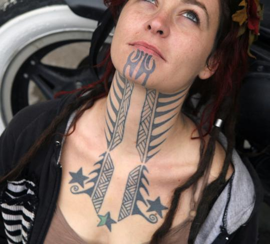 tattoo on her face. Local musician Holly Brewer, who started getting her face and neck tattoos