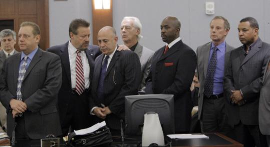 From left, Charles Cashmore, lawyer John Moran, Charles Ehrlich, lawyer William Terry, Michael McClinton, lawyer Robert Dennis Rentzer, and Walter Alexander appeared at the Clark County Regional Justice Center in Las Vegas yesterday.