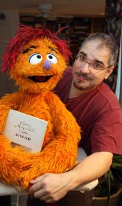Emmy-winning Muppet designer and artist Ed Christie with one of his creations, Kubik, the Muppet who likes science. © 2009 SESAME WORKSHOP
