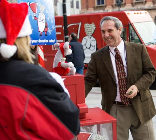 Stephan Delgreco of Rowley made a donation to Globe Santa on Boylston Street in Boston last week.