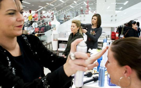 Yoon S. Byun/Globe StaffErin McDonough (center) and Katie Hutt (front) had their hair done by stylists at the Saks Fifth Avenue ''Holiday Cheer is Free'' event in Boston.