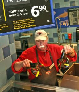 Barry Wade unloaded 35 pounds of chix lobsters at Hannaford Supermarket in Wells, Maine,