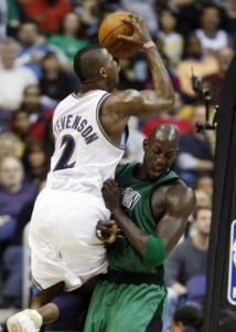 DeShawn Stevenson is out for a drive, but the Celtics' Kevin Garnett presents a roadblock.