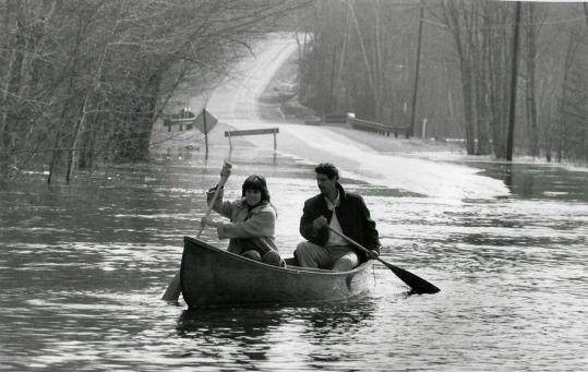 Ernest Hebert and Jan Kerouac during an impromptu canoe ride through flooded streets in Maine in April 1987.