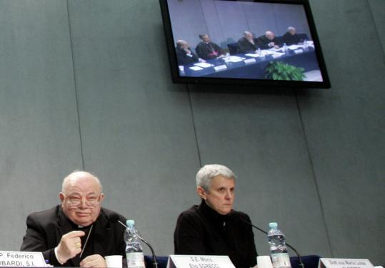 Bishop Elio Sgreccia, left, and professor Maria Luisa di Pietro, bioethics specialists, looked on during a news conference.